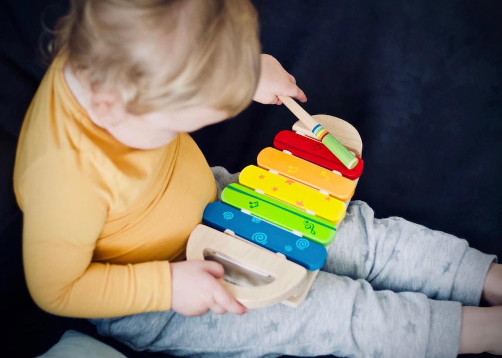 Toddler playing music