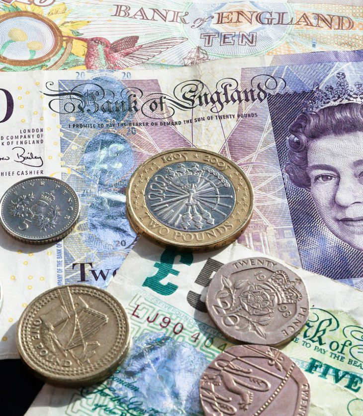 Photo of various types of British currency.
